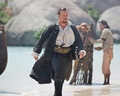 This publicity photo provided by Starz Entertainment, LLC shows, from left, Toby Stephens as Captain Flint, in a scene from