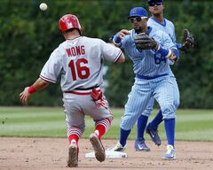 Chicago Cubs second baseman Emilio Bonifacio forces out the St. Louis Cardinals' Kolten Wong on a double play hit by Matt Holliday during the sixth inning of a baseball game on Sunday, July 27, 2014, in Chicago. (AP Photo/Andrew A. Nelles)