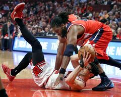 Chicago Bulls guard Kirk Hinrich scrambles for a loose ball with Washington Wizards forward Nene Hilario during Game 5 of an NBA basketball first-round playoff series, Tuesday, April 29, 2014, in Chicago. The Wizards won 75-69, taking the series. (AP Photo/Daily Herald, Steve Lundy) MANDATORY CREDIT MAGS OUT