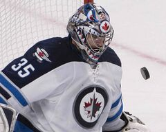 Jets goalie Al Montoya makes a save during third period  action against the Montreal Canadiens in Montreal on Sunday.