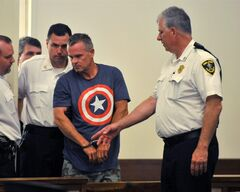 James Lacroix, second from right, is escorted into Barnstable District Court on Wednesday morning, July 16, 2014, in Barnstable, Mass after being evaluated by a court appointed psychiatrist . Lacroix is accused of breaking into the Kennedy compound on Cape Cod on Tuesday. (AP Photo/The Cape Cod Times, Steve Heaslip) MANDATORY CREDIT; MAGS OUT; NO SALES; TV OUT