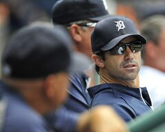 "Detroit Tigers manager Brad Ausmus, center, sits in the dugout during a baseball game against the the Kansas City Royals at Comerica Park in Detroit on Wednesday, June 18, 2014, which the Tigers lost 2-1. After the game, Ausmus had to immediately apologize after he said he went home and beat his wife after a loss. Ausmus quickly added: ""I'm just kidding. Luckily, my wife and kids are fantastic. I do get a little mopey at home but my wife and kids are good; they've seen me be in a bad mood after a loss, so they've been great."" After the next question, Ausmus apologized again.""I didn't want to make light of battered women,"" he said. ""I didn't mean to make light of that, so I apologize if I offended anyone. Let's move past that to the next question, sorry."" (AP Photo/The Detroit News, Robin Buckson)"