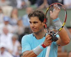 Spain's Rafael Nadal celebrates wining his fourth round match of the French Open tennis tournament against Serbia's Dusan Lajovic at the Roland Garros stadium, in Paris, France, Monday, June 2, 2014. Nadal won in three sets 6-1, 6-2, 6-1. (AP Photo/Michel Spingler)