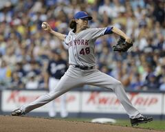 New York Mets starting pitcher Jacob Degrom throws to the Milwaukee Brewers during the first inning of a baseball game Sunday, July 27, 2014, in Milwaukee. (AP Photo/Jeffrey Phelps)