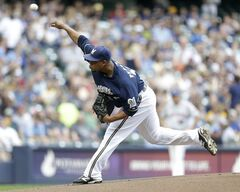 Milwaukee Brewers starting pitcher Wily Peralta throws to the New York Mets during the first inning of a baseball game Saturday, July 26, 2014, in Milwaukee. (AP Photo/Jeffrey Phelps)