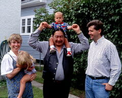 Elijah Harper hoists Gordon Elijah Mackintosh atop his shoulders in this 1991 family photo with Gord Mackintosh (right), and wife Margaret and daughter Cotelle.