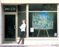Royalwood-based artist Cindy Dyson with one of her paintings earlier this year.