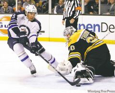 Evander Kane dekes Bruins goalie Tim Thomas to score a beauty in Beantown earlier this season.