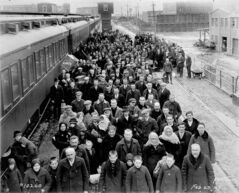 Immigrants arrive at the CPR station at Higgins Avenue and Main Street in 1927. The station (not seen in photo)  is now the Aboriginal Centre of Winnipeg.
