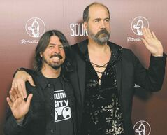 Dave Grohl, left, poses with Nirvana bandmate Krist Novoselic