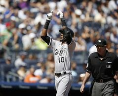 Chicago White Sox's Alexei Ramirez (10) gestures at the plate after hitting a first-inning solo home run off New York Yankees starting pitcher Chris Capuano in a baseball game at Yankee Stadium in New York, Sunday, Aug. 24, 2014. (AP Photo/Kathy Willens)