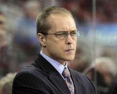 The Carolina Hurricanes' Paul Maurice watches from the bench during a game in Raleigh, North Carolina in November 2011.