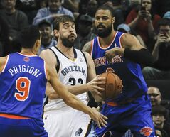 Memphis Grizzlies center Marc Gasol (33), of Spain, gets blocked in by New York Knicks guard Pablo Prigioni (9), of Argentina, and center Tyson Chandler (6) in the first half of an NBA basketball game, Tuesday, Feb. 18, 2014, in Memphis, Tenn. (AP Photo/Lance Murphey)