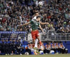 Mexico defender Diego Reyes, front, and South Korea forward Kim Shin-Wook compete for possession during the first half of an international friendly soccer match on Wednesday, Jan. 29, 2014, in San Antonio. (AP Photo/Darren Abate)