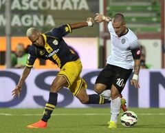 Cesena's Manuel Coppola, right, vies for the ball with Parma's Jonathan Biabiany of France, during their Serie A soccer match at Cesena's Manuzzi stadium, Italy, Sunday, Aug. 31, 2014. (AP Photo/Marco Vasini)