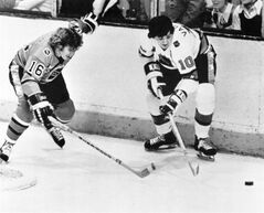 FILE - In this Jan. 22, 1975, file photo, Carol Vadnais (10) of the Prince of Wales division, battles for possession with Bobby Clarke (16) of the Clarence Campbell division during the annual All-Star contest in Montreal. Vadnais, a six-time all-star, has died. He was 68. The New York Rangers reported on their website that Vadnais, who spent seven seasons with the team, passed away Sunday. A cause of death was not given. (AP Photo/The Canadian Press, File)