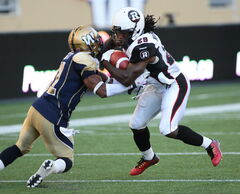 Winnipeg Blue Bombers' Maurice Leggett ties it up with Ottawa Redblacks Chevon Walker during the July 3 game at Investors Group Field. Leggett was injured in that game and may not play this Friday.