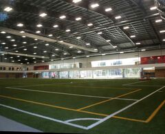 A view through a window of the new indoor soccer facility at the University of Winnipeg.