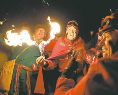 Visitors from the St. Paul Winter Festival in Minnesota, who call themselves Vulcans, play with fire to fight winter at the festival opener Friday.