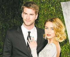 FILE - This Feb. 26, 2012 file photo shows Miley Cyrus, right, and Liam Hemsworth at the Vanity Fair Oscar party in West Hollywood, Calif. The couple who met on the set of that movie in 2009 announced their engagement Wednesday morning. Publicist Jeff Raymond confirms a People Magazine report of the news. Hemsworth, the 22-year-old Australian star of
