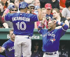 Toronto's Edwin Encarnacion is greeted by teammate Emilio Bonifacio  after going deep at Fenway Park on Sunday.