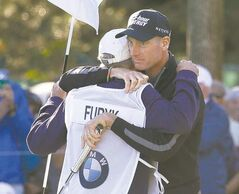 Jim Furyk hugs his caddie, Mike Cowan, after posting a 12-under-par 59.