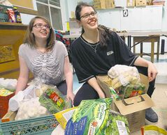 Sam Henrickson (left) and Alycia Leafloor feel an obligation to give back to their community.