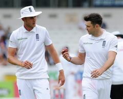 England's James Anderson, right, talks with Stuart Broad during their Second Test Match against Sri Lanka at Headingley cricket ground, Leeds, England, on Friday, June 20, 2014. (AP Photo/Rui Vieira)
