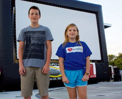 Transcona residents Ben and Jolene Galagan are shown in front of the big screen prepared to show Beethoven's Christmas Adventure at Transcona Centennial Square on Aug. 15. The siblings were extras in the film.