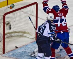 Montreal Canadiens right-winger Erik Cole celebrates a goal by teammate Josh Gorges against Winnipeg Jets goalie Winnipeg Jets goalie Ondrej Pavelec during first-period action in Montreal Wednesday.