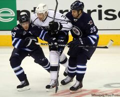 Winnipeg Jets Tobia Enstrom and Patrice Cormier put a stop to Jack Johnson of the L.A. Kings on Thursday at the MTS Centre.
