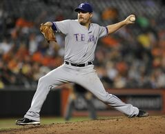 Texas Rangers pitcher Joe Saunders throws against the Baltimore Orioles in the fifth inning of a baseball game, Monday, June 30, 2014, in Baltimore. The Orioles won 7-1. (AP Photo/Gail Burton)