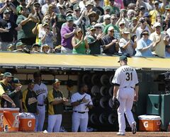 Oakland Athletics' Jon Lester (31) receives a standing ovation from fans as he leaves the baseball game against the Kansas City Royals in the seventh inning Saturday, Aug. 2, 2014, in Oakland, Calif. (AP Photo/Ben Margot)