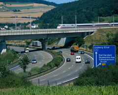 Near Bad Hersfeld: autobahn and railway with InterCity-Express train.