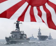 In this Oct. 14, 2012 photo, Japan Maritime Self-Defense Force (JMSDF) escort ship Kurama leads other vessels during a fleet review in waters off Sagami, south of Tokyo. Japanese Prime Minister Shinzo Abe's spending package, announced Friday, Jan. 11, 2013, includes plans a request to raise military spending for the first time in a decade - an increase partly aimed at beefing up monitoring and defenses around the disputed islands - called Senkaku in Japanese and Daioyu in Chinese - in the East China Sea, controlled by Japan but also claimed by China and Taiwan. (AP Photo/Itsuo Inouye)