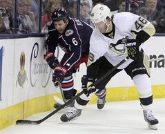 Pittsburgh Penguins' Joe Vitale, right, and Columbus Blue Jackets' Nikita Nikitin, of Russia, chase a loose puck during the third period of Game 4 of a first-round NHL playoff hockey series on Wednesday, April 23, 2014, in Columbus, Ohio. The Blue Jackets have traded Nikitin to the Edmonton Oilers in exchange for a fifth-round draft pick. THE CANADIAN PRESS/AP/Jay LaPrete