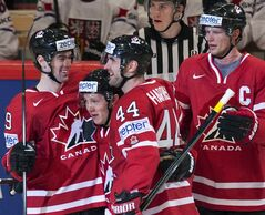 Canada's Jeff Skinner, second from left, is congratulated by teammates Justin Schultz, left, Jay Harrison, centre, and Eric Staal after scoring the winning goal against the Czech Republic during third period preliminary round action Sunday, May 12, 2013 at the world hockey championship in Stockholm, Sweden. THE CANADIAN PRESS/Jacques Boissinot
