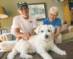 Ron (left) and Penny Maletic and their 10-year-old Bichon Frise Teddy.