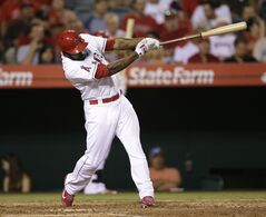Los Angeles Angels' Howie Kendrick hits an RBI single during the eighth inning of a baseball game against the Detroit Tigers on Saturday, July 26, 2014, in Anaheim, Calif. (AP Photo/Jae C. Hong)