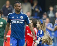Chelsea's Ashley Cole, walks around the pitch with his children at the end of their English Premier League soccer match against Norwich City, at the Stamford Bridge Stadium in London, Sunday, May 4, 2014. (AP Photo/Bogdan Maran)
