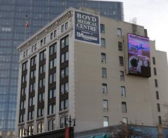 The electronic sign on the side of the Boyd Building weighs 9,000 kilograms and will require specialized equipment to remove, the owners say.