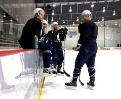 Bryan Little (left), Ryan Reaves, Mark Stuart and Andrew Ladd (standing) at the MTS Iceplex today.