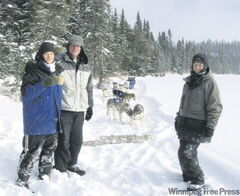 The Obergs on the shores of a frozen lake, midway through a 29-kilometre dogsled expedition.