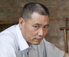 In this June 20, 2012 file photo, human rights lawyer Pu Zhiqiang works near his computer in Beijing. Chinese police have detained Pu since June 13 in a government clampdown on activists ahead of the 25th anniversary of the Tiananmen Square military suppression of protesters, an attorney said Thursday, May 15, 2014. Pu's aide, Qu Zhenhong, who is also his niece, was recently detained by Beijing police on suspicion of