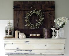 A mantle created and finished by Shannon and Dean Acheson is seen in this undated handout photo. The couple created the mantle last fall with odds and ends of wood from some pine skirts from an old table, leftover baseboard and trim, along with a couple of new pieces of wood just to complete the piece, which they painted, aged and waxed. THE CANADIAN PRESS/HO - AKA Design