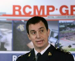 Assistant commissioner Gilles Michaud, the commanding officer of the RCMP's national division, speaks at a news conference in Ottawa on Tuesday, Feb. 4, 2014. RCMP have charged former senator Mac Harb and suspended senator Patrick Brazeau with fraud and breach of trust over their Senate expenses. THE CANADIAN PRESS/Fred Chartrand
