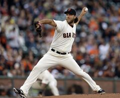 San Francisco Giants' Madison Bumgarner works against the Pittsburgh Pirates in the first inning of a baseball game Monday, July 28, 2014, in San Francisco. (AP Photo/Ben Margot)