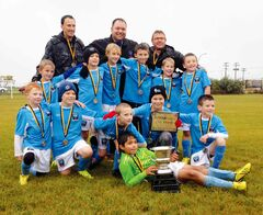 The Phoenix U9 (Team Marsh) boys' soccer team battled back from a slow start to the season to finish with a city championship. Phoenix came back in the final, too, overcoming a 1-0 deficit at the half to down undefeated Bonivital 4-2. Back row: Ryan Hogsden (assistant coach), Brent Marsh (head coach), Kal Loewen (assistant coach). Middle row: Cohen Rowe, Andrew Roesler, Bryce Bell, Josh Earle, Ethan Dueck, Ben Marsh.  Front row: Ethan Hogsden, Kaedan Loewen, Daniel Kreis, Thaddeus Biggras, Brett Landreville. Lying down: Ranveer Sandu.
