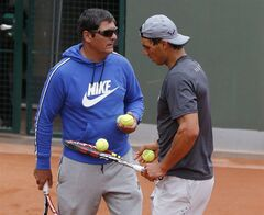 Spain's Rafael Nadal, right, listens to his coach and uncle Toni Nadal during a training session for the French Open tennis tournament, at the Roland Garros stadium in Paris, Saturday, May 24, 2014. The French Open tennis tournament starts Sunday. (AP Photo/Michel Euler)