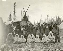 A group of Island Lake Oji-Cree at their winter camp in the 1920s.